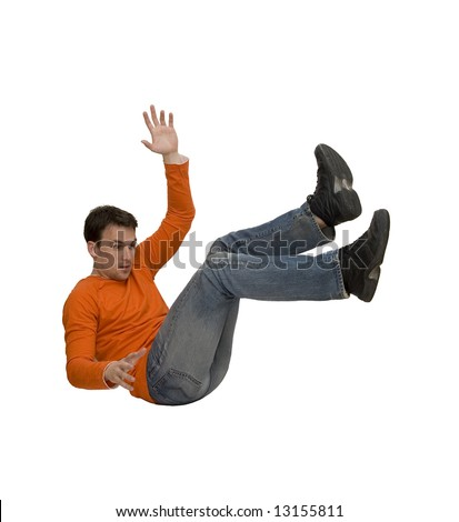 young man falling studio isolated - stock photo
