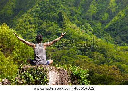 Young man feeling free in nature. Peace and relaxation concept.  - stock photo