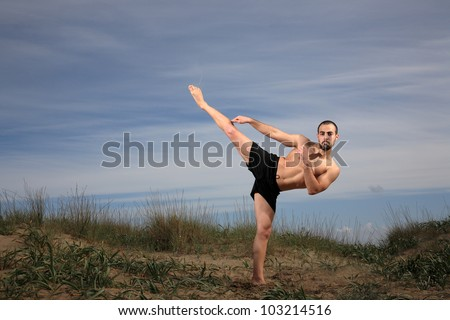 young man fighter exercising outdoor,motion blur - stock photo