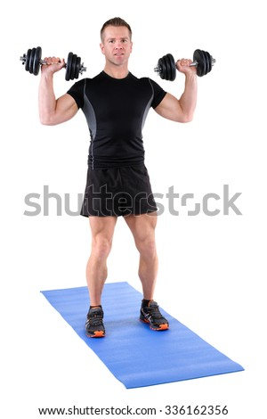 young man fitness instructor shows starting position of standing dumbbell shoulder press, isolated on white - stock photo