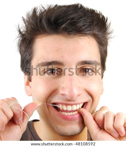 young man flossing his teeth isolated on white background - stock photo