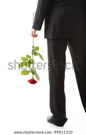 Young man flower - red rose isolated white background - stock photo