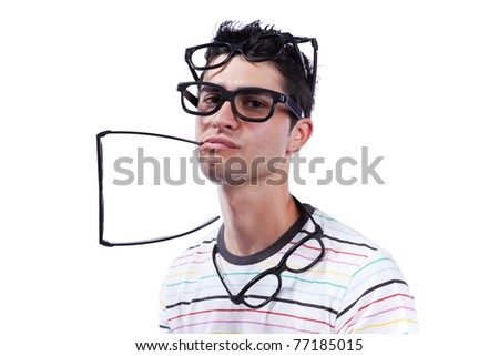 Young man full of eye glasses on his head (isolated on white) - stock photo