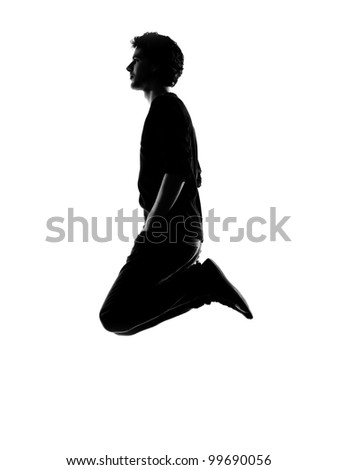 young man funny jumping silhouette in studio isolated on white background - stock photo