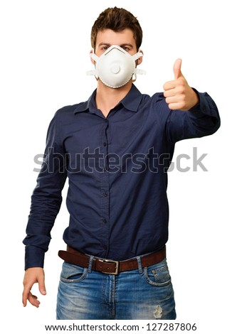 Young Man Gesturing And Wearing Mask On White Background - stock photo