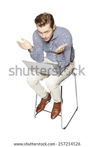 Young man gesturing by hands. He is disappointed. - stock photo