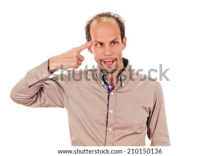 young man gesturing with his finger against his temple. Isolated on white background - stock photo