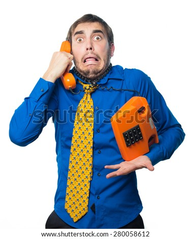 young man getting bad news by phone, in a retro orange phone isolated on white background - stock photo