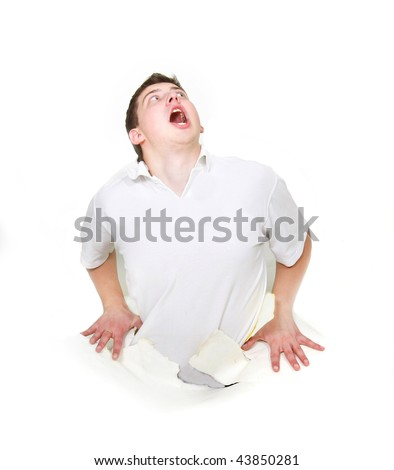 young man getting out through hole in paper - stock photo