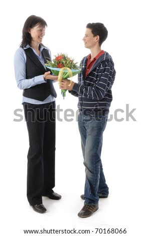 Young man gives his mother a large bouquet of flowers, isolated on a white background. - stock photo