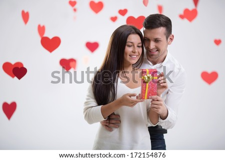 Young man giving a gift - stock photo