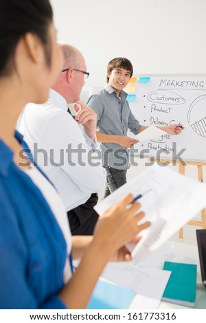 Young man giving business seminar