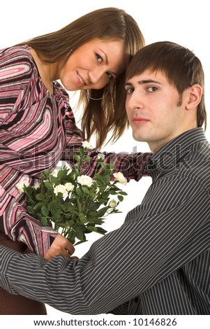 young man giving flower to darling girl