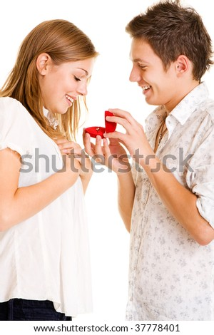 young man giving his girlfriend ring. isolated on white - stock photo