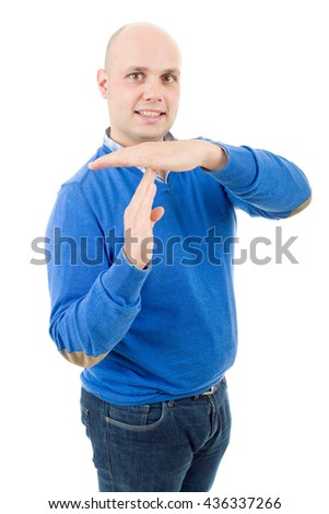 Young man giving showing time out hands gesture isolated on white background - stock photo