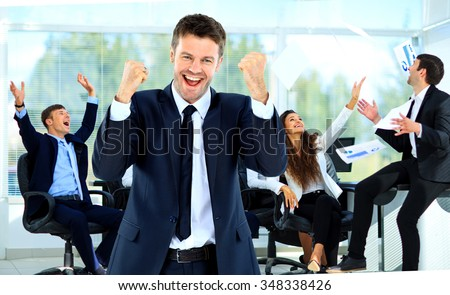 young man glad in the background of gladness  team - stock photo