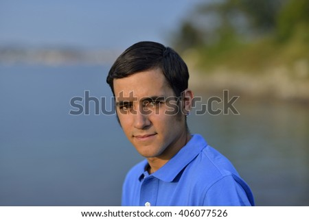 Young man golf player, portrait - stock photo