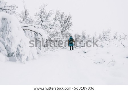 Young man got lost in the winter snowy field