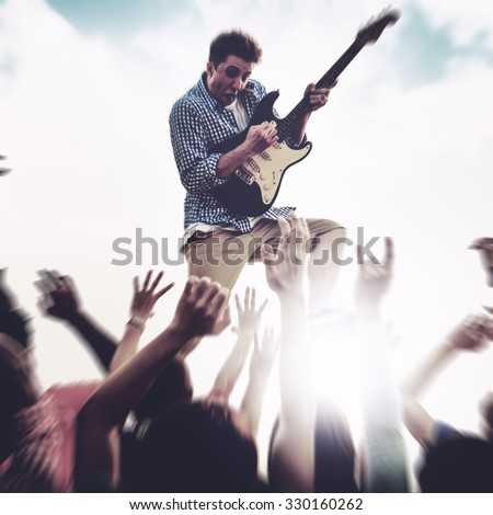 Young Man Guitar Performing Concert Ecstatic Crowds Concept - stock photo
