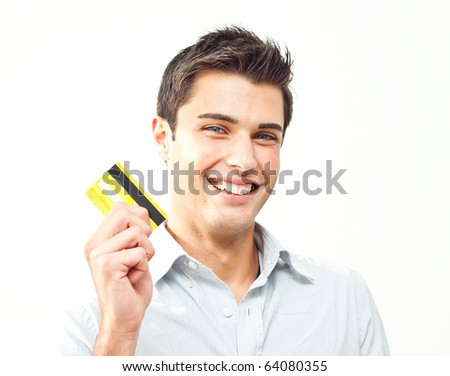 Young man happy holding credit card - stock photo