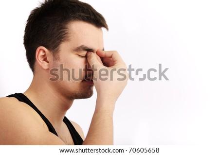 Young man having a headache - stock photo
