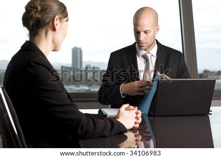 Young man having a job interview in a beautiful office