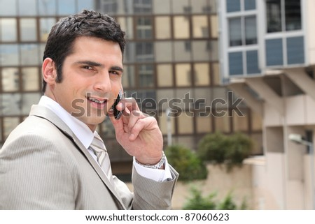 Young man having conversation on phone - stock photo