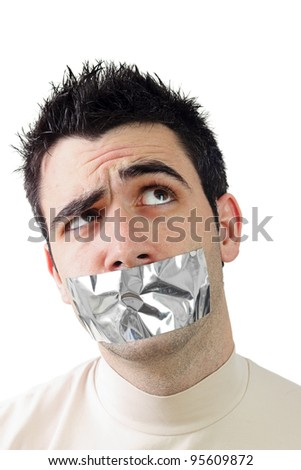 Young man having gray duct tape on his mouth.Wondering expression on his face.White background and copy space. - stock photo