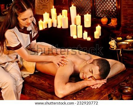 Young man having oil Ayurveda spa treatment. - stock photo