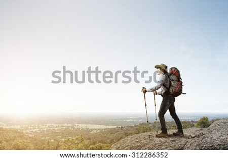 Young man hiker walking in beautiful mountain nature landscape