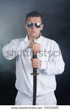 Young man hold sword