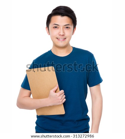 Young man hold with clipboard - stock photo