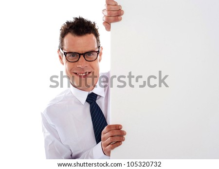 Young man holding a big white blank  signboard and looking at camera - stock photo