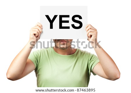 """young man holding a billboard with word """"yes"""" isolated on white background - stock photo"""