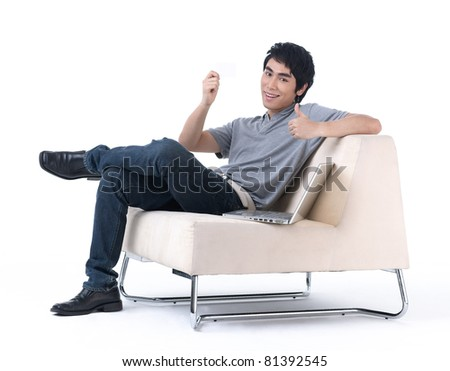 Young man holding a blank white card for you to put some text on it - stock photo