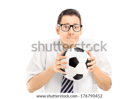 Young man holding a football and watching sports match isolated on white background - stock photo