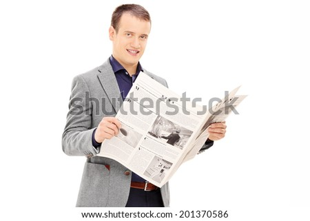 Young man holding a newspaper and looking at camera isolated on white background