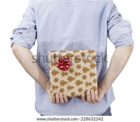 Young man holding a present in hands. - stock photo