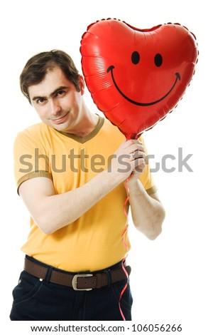 young man holding a red heart shaped balloon isolated on white background - stock photo