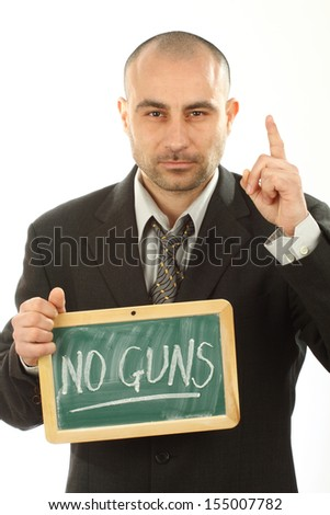 young man holding a sign saying no weapons - stock photo
