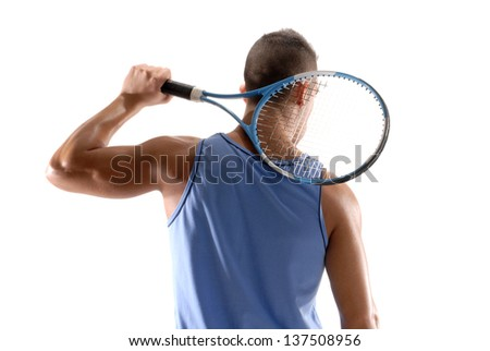Young man holding a tennis racket on white background.