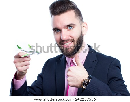 Young man holding a toy plane and thumb up - stock photo