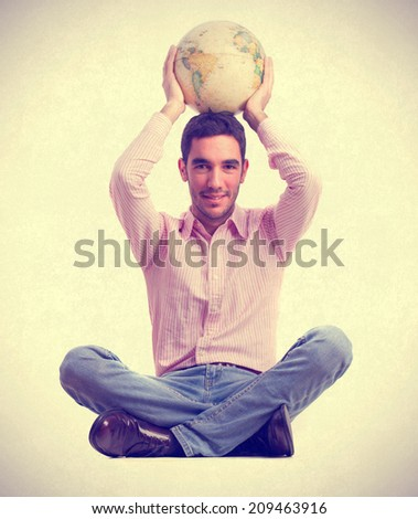 young man holding a world globe - stock photo