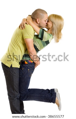 young man holding and kissing his girlfriend in the air