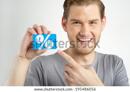 young man holding and showing card  - stock photo