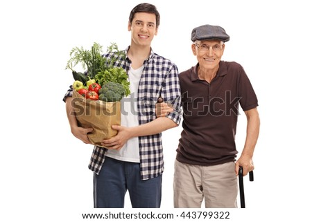 Young man holding bag of groceries and posing with his grandpa isolated on white background - stock photo