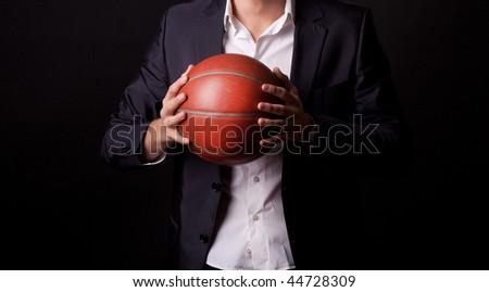 Young man holding basketball ball - stock photo