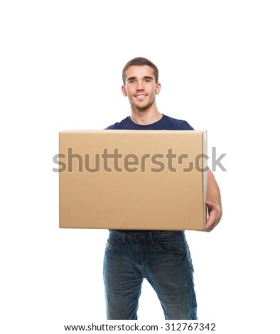 young man holding big cardboard box in front of himself on white background - stock photo