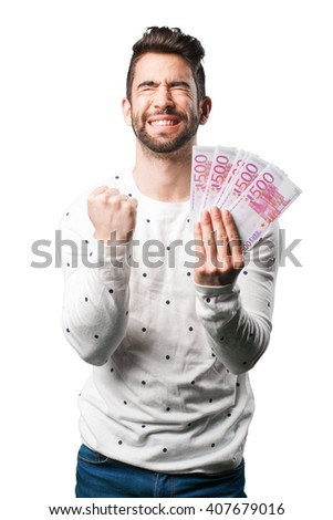 young man holding bills - stock photo