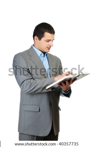 Young man holding book isolated on white background